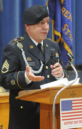 Amesbury: VFW Post 2016 Commander Russ Saboo welcomes guest to  the 12th annual Support the Troops Christmas Dinner and reception at Holy Parish Hall in Amesbury. Jim Vaiknoras/staff photo