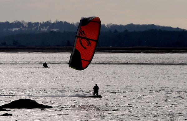 Salisbury: Jay Oczkowski of Seabrook kite surfs in the afternoon sun near the Salisbury Reservation boat dock Saturday. Jim Vaiknoras/staff photo