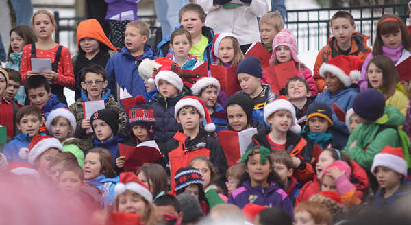 Amesbury: Amesbury Elementery students under the direction of music teacher Alicia Harlov sing holiday songs at the Upper Millyard in Amesbury Friday afternoon. Jim Vaiknoras/staff photo