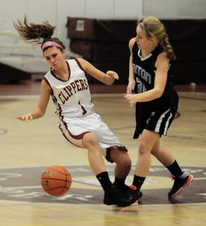 newburyport: Newburyport's Aly Leahy is fouled by Triton's Erin Savage during their game in the 10th annual Institution for saving Holiday Basketball tournament Friday night at Newburyport high. JIm Vaiknoras/staff photo