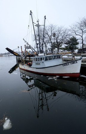 Newburyport: The fishing boat Early Times is reflected in the still water at the embayment at Market Landing Park in Newburyport.Jim Vaiknoras/staff photo