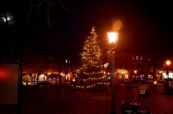 JIM VAIKNORAS/Staff photo  The annual Christmas Tree in Market Square in Newburyport illuminates the late autumn night.