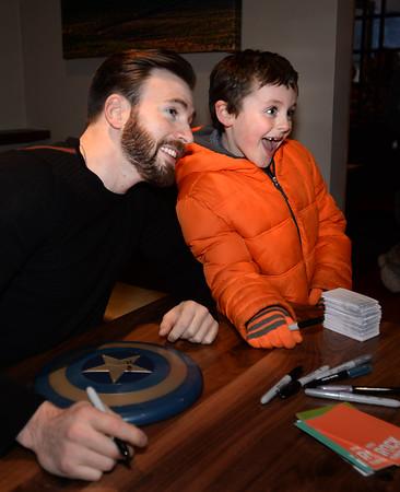 BRYAN EATON/ Staff Photo. Aidan Barber, 8, of Newburyport shows his excitement when meeting actor Chris Evans.