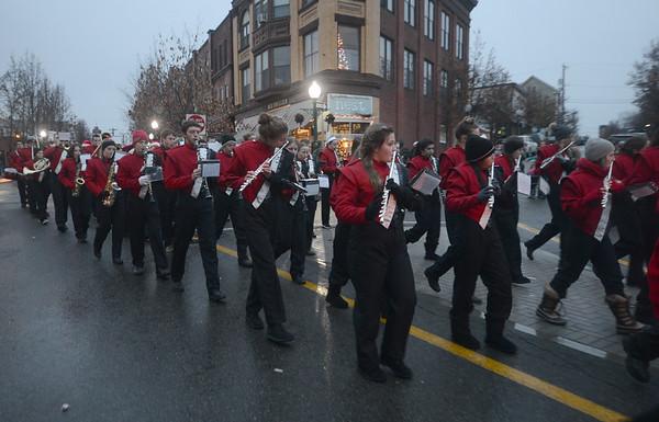 JIM VAIKNORAS/Staff photo The Amesbury high marching band makes it's way towards Market Square at the Amesbury Santa parade Saturday.