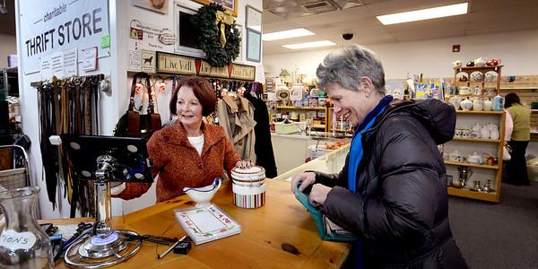 BRYAN EATON/ Staff Photo. Leeward Light volunteer Laurice Haines makes a sale to Meg Rayne of Newburyport.