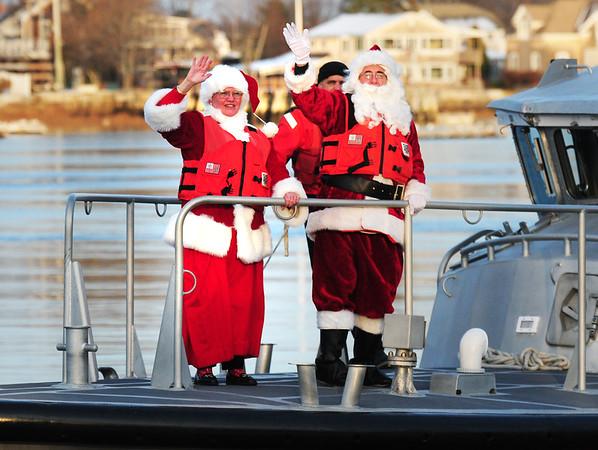 BRYAN EATON/ Staff Photo. Santa and Mrs. Claus arrive to Newburyport's waterfront via the US Coast Guard's motor lifeboat.
