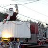 JIM VAIKNORAS/Staff photo Santa begins his annual tour of Salisbury on the back of a Salisbury fire truck.