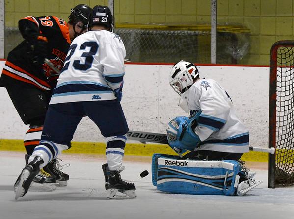 BRYAN EATON/ Staff Photo. Triton goalie Nolan Smith stops a shot by a Newton player at the Graf Rink.