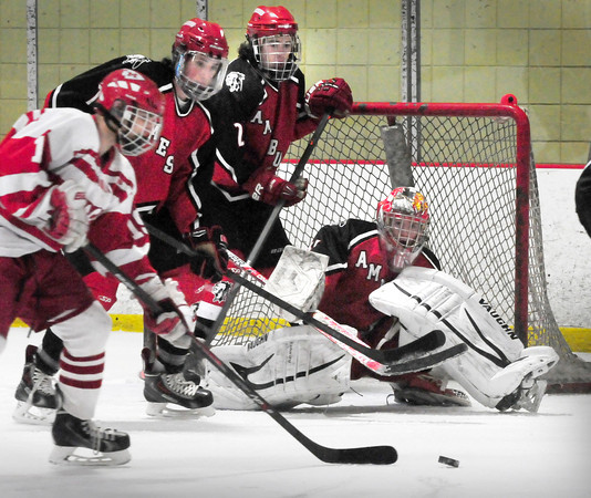 Newburyport: Amesbury goalie Jake Harlow readies for a goal attempt by Masconomet, which came up short on this drive, though Masco got four goals in the first period. Bryan Eaton/Staff Photo