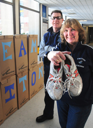 Byfield: Triton Regional School District facilities manager Chris Walsh, left, and athletic department secretary Karen Atherton have spearheaded a drive to collect used sneakers to help raise money for renovation of the high school's stadium. Bryan Eaton/Staff Photo