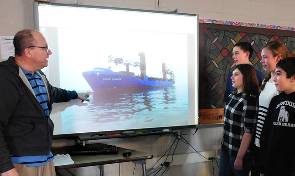 "Byfield: Math teacher Mark Wilson, left, and his eighth grade students at Triton Middle School have ""adopted"" the ship Ocean Charger sponsored by the Propeller Club of the U.S. During the year the students will communicate with the ship learning about math in navigation as well as geography, history, science and transporatation. Bryan Eaton/Staff Photo"