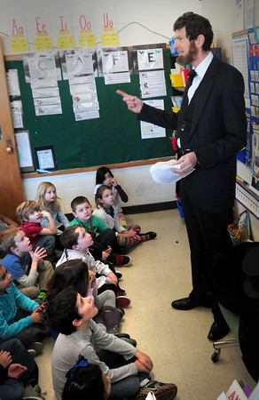 Newburyport: Bresnahan School first grade classes got to hear the life story of the 16th president on the day of his birthday on Wednesday. Abraham Lincoln, a.k.a. Gus Harrington, speaks here in his wife, Susan Harrington' class. Bryan Eaton/Staff Photo