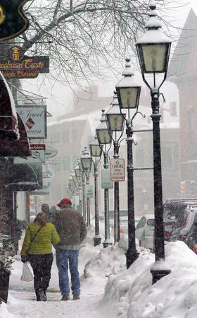Newburyport: Snow falls once again on Pleasant Street in Newburyport yesterday from the third storm in six days. A warmup is on the way with possible rain in the forecast as well. Bryan Eaton/Staff Photo