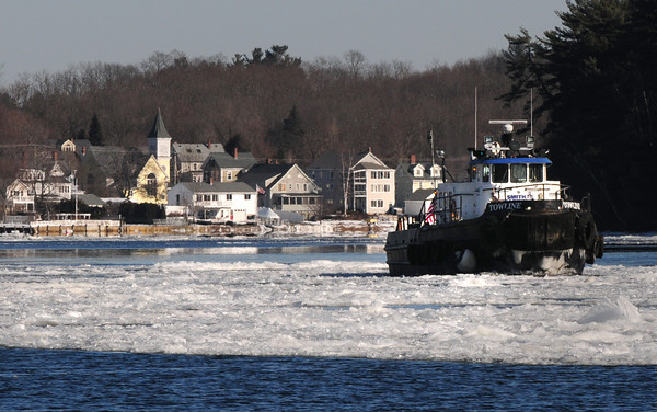 Amesbury: An ice breaker resembling a tugboat has been cracking through the ice floes in the Merrimack River in the area of Amesbury's Point Shore on an almost constant basis. The ice is being broken into smaller pieces to prevent the hampering of river-based equipment in the construction of the new Whittier Bridge. Bryan Eaton/Staff Photo