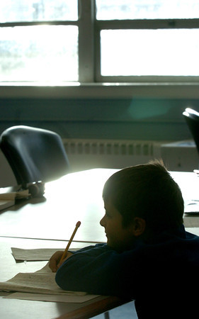 Salisbury: The bright sun doesn't convey how cold it it outside as it shines on Jonathan Zinck, 8, of Newburyport. He and a half dozen other children were in the homework room at the Boys and Girls Club in Salisbury on Tuesday afternoon. Bryan Eaton/Staff Photo