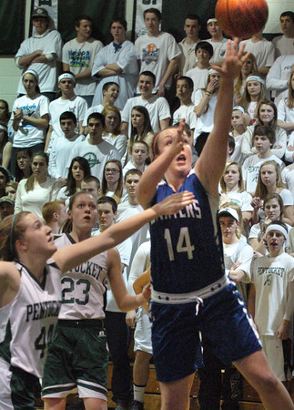 West Newbury: Pentucket's Audrey Tipson covers Danvers' Emily McNulty who goes for two but was called for traveling. Bryan Eaton/Staff Photo