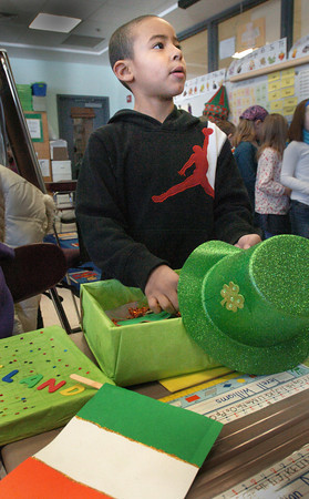 Amesbury: Terell Williams, 7, reports his research on Ireland to other second-graders at the Cashman Elementary School. The students used a culture kit to learn about other countries of their choosing and then shared the results of their findings. Bryan Eaton/Staff Photo