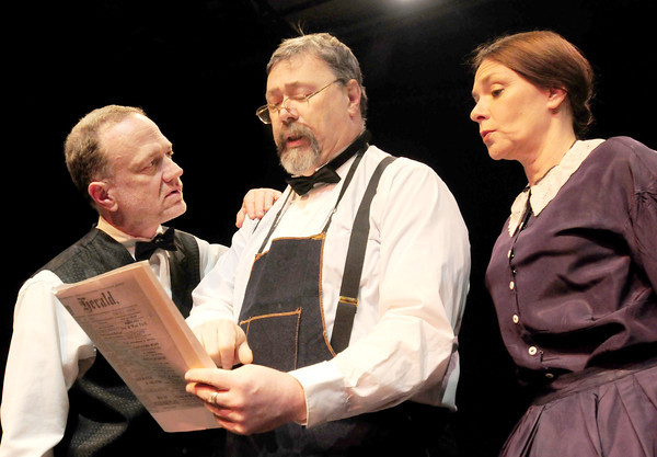 Newburyport: Proofing the paper, from left, Charlie Bradley as William Huse, Woody Eugene Woodiel as Ephram Allen, editor of the Newburyport Herald and narrator Kimberly Holliday. Bryan Eaton/Staff Photo