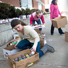 "Byfield: Triton Middle School eighth-graders, from left, Morgan Monroe, Stephanie Proctor and Kendra Knight load canned and jarred food into a boxtruck to take to local food pantries. Seventh and eighth grade teams competed to collect food pantry items and cash in their annual ""Canuary Food Drive"" which raised nearly $2,000 and 5,000 food and other items in need of by social agencies. Bryan Eaton/Staff Photo"