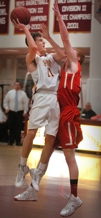 Newburyport: Newburyport's Mike Shay falls short on two points after getting a rebound from Masconomet. Bryan Eaton/Staff Photo