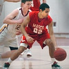 Newburyport: Newburyport's Dan Baribeault puts some pressure on Masco's Jalen Aho. Bryan Eaton/Staff Photo
