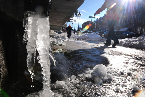 Newburyport: Though the thermometer only made it to the upper 20's yesterday, the sun was strong enough to cause some melting, and dripping, on State Steet in Newburyport. Bryan Eaton/Staff Photo