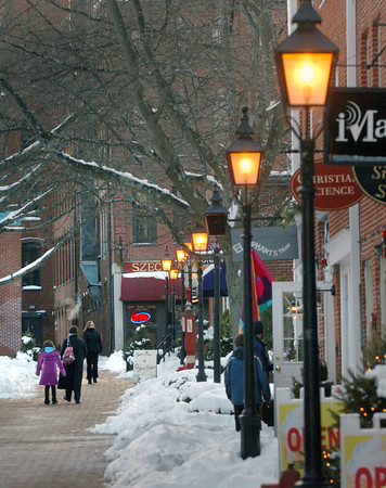 Newburyport: It's still a wintry scene on Inn Street as winter is still keeping a firm grip on the weather, though some warming is forecast starting this weekend. One good sign is the lampposts are going on later as the sun is setting later. Bryan Eaton/Staff Photo