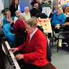 Amesbury: Ed Wadsworth of Amesbury plays some Scott Joplin music during the Amesbury Council on Aging's Winter Mixer on Thursday afternoon. The center's seven interns helped out at the event which coincided with Human Connection Month. Bryan Eaton/Staff Photo