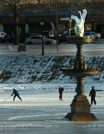 Newburyport: Youngsters play some hockey Thursday on the Frog Pond at Bartlet Mall in Newbury. Some ice could get a little puddly over the weekend at the temperature is to rise into the low 40's. Bryan Eaton/Staff Photo