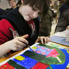 Amesbury: Emma Mackie, 10, works on a scene of a town in Sara Connor's art class at Amesbury Elementary School on Thursday. The fourth-graders were learning about different scapes as landscapes, oceanscapes, etc. Bryan Eaton/Staff Photo