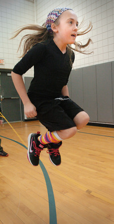 """Salisbury: Teagan Wilson, 9, practices jumping rope in Linda Gangemi's physical education class at Salisbury Elementary School on Wednesday afternoon. Children were readying for next week's """"Jump Rope For Heart"""" which teaches the students about the importance of cardio health and is a fundraiser for the American Heart Associaton. Bryan Eaton/Staff Photo"""