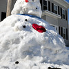 Newburyport: With temperatures in the mid-40's and rain on the way, this snowman's days are numberered. Indeed his pipe has fallen out already where he was built at the corner of Buck and Washington Streets in Newburyport. Bryan Eaton/Staff Photo