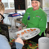 Newburyport: Regional chef for Chartwell's food service company, Barb Kempkel, hands out vegan food-Barbecue Saitan and Buffalo Tofu Bites-to students at lunch at Newburyport High. The company, which services the school, had a demonstration table to educate the students on healthy eating and to learn about what is in their food. Bryan Eaton/Staff Photo
