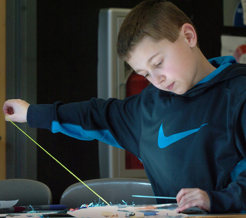 Salisbury: Matthew Maribito, 9, pulls out a piece of yarn while working on a weaving Tuesday morning. He was in Amy Merluzzi's art class at the Salisbury Elementary School. Bryan Eaton/Staff Photo