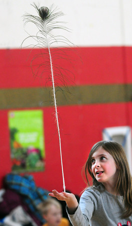 Newburyport: Gabriella Loughran, 8, balances a peacock feather in Jesse Craddock's physical education class at the Bresnahan School. She was at one of the skill stations where children practiced different skills throughout the school year. Bryan Eaton/Staff Photo