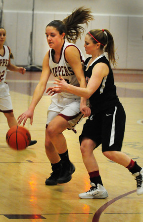 Newburyport: Newburyport's Emily Pettigrew moves the ball past Marblehead's Emily Freedland. Bryan Eaton/Staff Photo