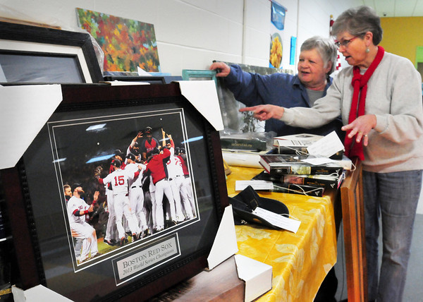 Newburyport: Parent volunteers from Opportunity Works, Sue Gagnon, left, and Janet Ryan catalog items for the organization's up coming Lend-A-Hand Auction this Saturday. A preview of items is scheduled for Thursday night. Bryan Eaton/Staff Photo
