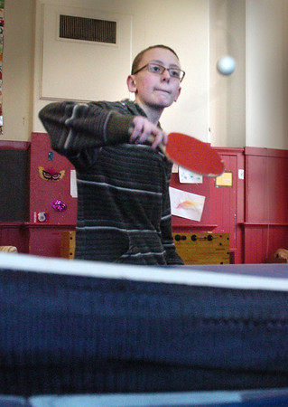 Newburyport: Shane Smith, 13, keeps his eye on the ball in a game of ping pong Wednesday afternoon. He was playing his friend, Aidan Kelley, 12, at the Kelley School Youth Center. Bryan Eaton/Staff Photo