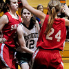 West Newbury: Kelsi McNamara gets squeezed by two Saugus defenders. Bryan Eaton/Staff Photo