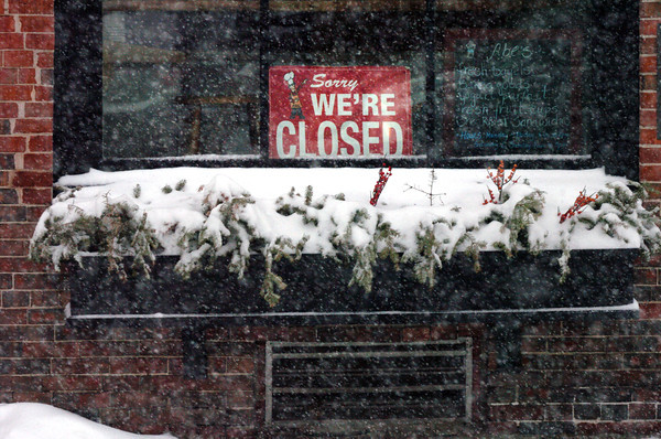 Newburyport: Many businesses were closed yesterday, and some closing early like Abraham's Bagels, here, and 17 State Street after serving customers in the morning. Bryan Eaton/Staff Photo