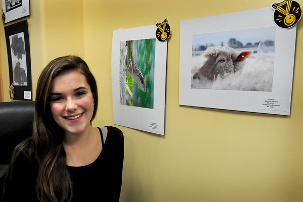 Byfield: Triton High senior Madison Williams, 18, with two of her award winning photos in the Boston Scholastic Art Awards. Bryan Eaton/Staff Photo