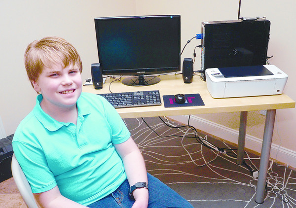 Newburyport: Ryan Gendron, 11, and his father started a program that sells low-cost computer bundles to families in need.<br /> Jim Vaiknoras/staff photo