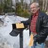 Rowley: George Gallant with a package he just recieved that was mailed in 2012. He's been fighting with the post office and dealing with issues with his service, from lost letters and a missing tax bill. Jim vaiknoras/staff photo