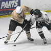 Newburyport: Pentucket's Patrick Slack fights for the puck with Haverhill's Eric Michitson during their game at the Graf Rink in Newburyport Friday night. Jim Vaiknoras/staff photo