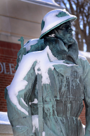 Amesbury: The doughboy statue at Amesbury Middle School in covered in Saturday nights snow. Jim Vaiknoras/staff photo