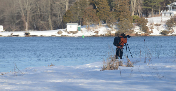 Amesbury: A photographer trains his lens on Eagle Isnad from Deer Island in Amesbury Saturday. Jim Vaiknoras/staff photo