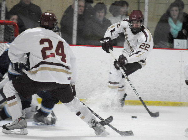 Newburyport: Newburyport's Ben Ventura looks to pass infront of Triton's net during the Newburyport Bank 19 Annual Hockey Classic. Amesbury won the game in a shootout. Jim Vaiknoras/staff photo