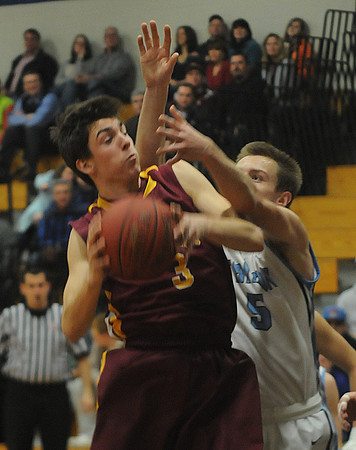 Byfield: Newburyport's Drew Bourdeau grabs a rebound over Triton's Jake Gilbert during their game at Triton . Jim Vaiknoras/staff photo