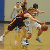 Byfield: Newburyport's Adam Traxler and Triton's Kevin Clark race for a loose ball during their game at Triton . Jim Vaiknoras/staff photo