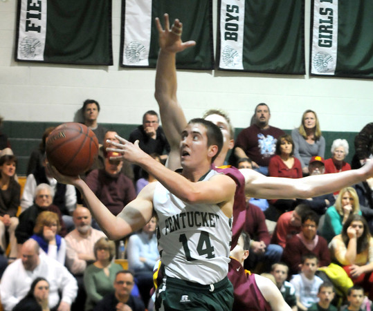 West Newbury:  Pentucket's Ryan Beaton glides to the hoop during the Sachem's game against Newburyport at Pentucket Friday night. Jim Vaiknoras/staff photo